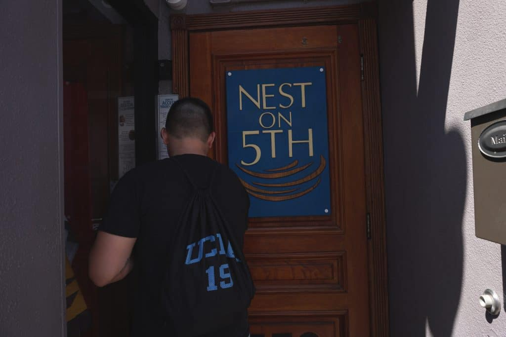 Daniel entering into Nest on Fifth in the heart of Gaslamp